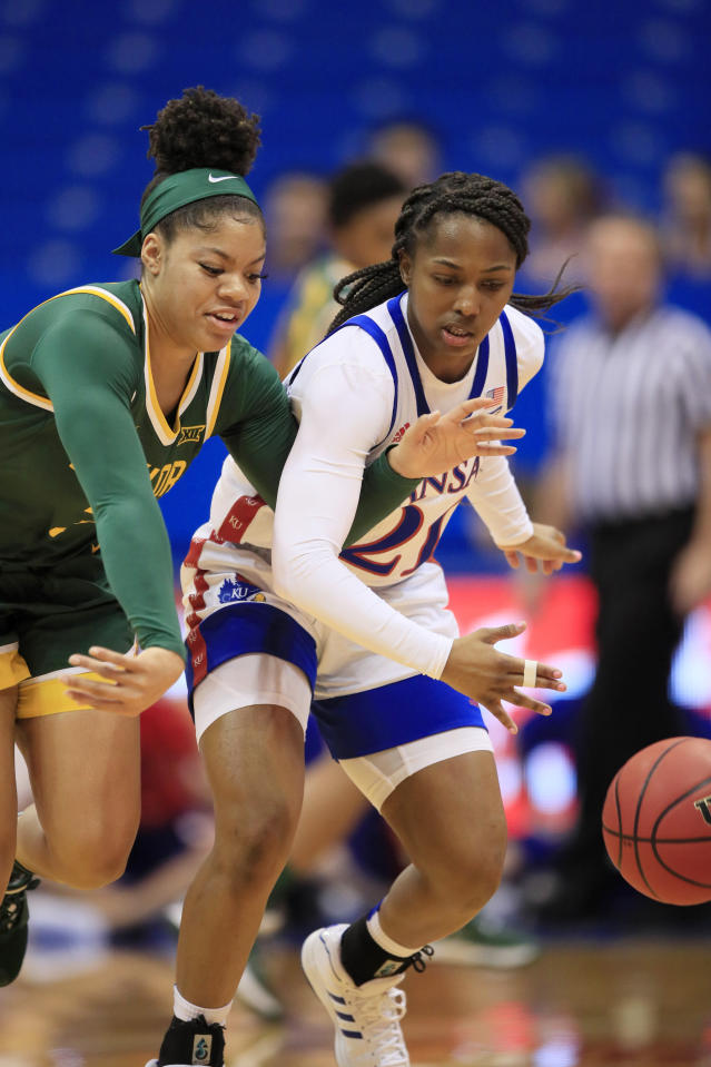 Baylor guard Trinity Oliver, left, and Kansas guard Brooklyn Mitchell (21) chase the ball during the first half of an NCAA college basketball game in Lawrence, Kan., Wednesday, Jan. 15, 2020. (AP Photo/Orlin Wagner)
