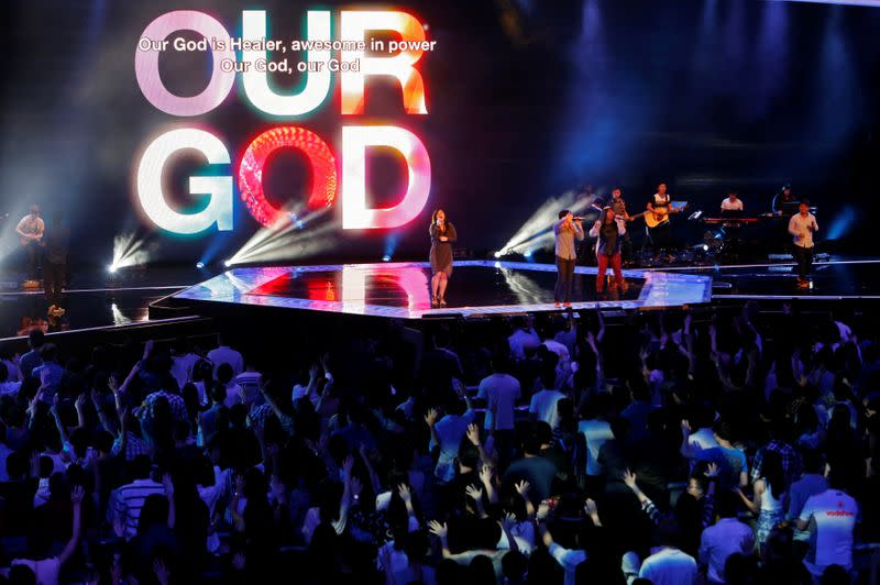 Singapore mega-church takes services online after virus cases jump