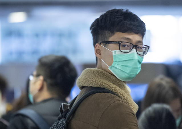 30 January 2020, Hessen, Frankfurt/Main: Face masks are worn by passengers waiting at Frankfurt Airport for the check-in of the Chinese airline Air China. For fear of the new coronavirus, many passengers wear masks. Photo: Boris Roessler/dpa (Photo by Boris Roessler/picture alliance via Getty Images)