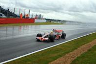 Rain king: Lewis Hamilton cruised to victory through the Silverstone puddles in 2008 (AFP/ANDREW YATES)