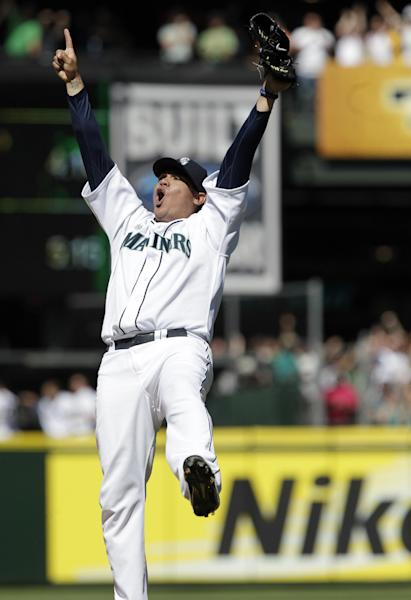 Seattle Mariners pitcher Felix Hernandez reacts after throwing a perfect game to end the ninth inning of baseball game against the Tampa Bay Rays, Wednesday, Aug. 15, 2012, in Seattle. The Mariners won 1-0. (AP Photo/Ted S. Warren)