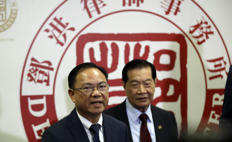 From left, attorney Daniel Deng and forensic scientist Henry Lee hold a joint news conference regarding the fatal police shooting of Chinese immigrant Li Xi Wang Wednesday, Aug. 28, 2019, in Rosemead, Calif. Lawyers are pursuing claims against the city of Chino, Calif., for the fatal shooting of an unarmed man by a police officer who was part of team serving a search warrant on a suspected illegal marijuana operation. (AP Photo/Marcio Jose Sanchez)