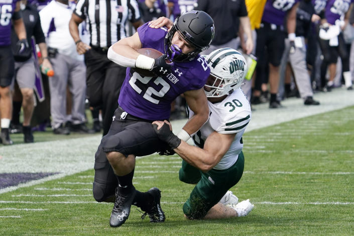 Northwestern running back Connor Newhouse, left, is tackled by Ohio linebacker Ben Johnson during the second half of an NCAA college football game in Evanston, Ill., Saturday, Sept. 25, 2021. Northwestern won 35-6. (AP Photo/Nam Y. Huh)