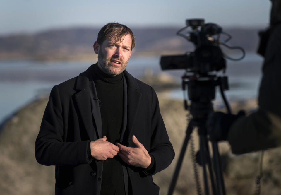 """Jonas Holmberg, creative director of Goteborg Film Festival is interviewed by the Associated Press, on the island of Hamneskar, western Sweden on Saturday, Jan. 30, 2021. The 44th Goteborg film festival opened this weekend in a mostly virtual format but an emergency ward nurse from Sweden was selected among 12,000 volunteers to spend a week on an isolated island in the North Sea with for only companionship the events' entire movie selection. Lisa Enroth said the opportunity gave her """"time to reflect"""" after a busy year amid the COVID pandemic. (AP Photo/Thomas Johansson)"""