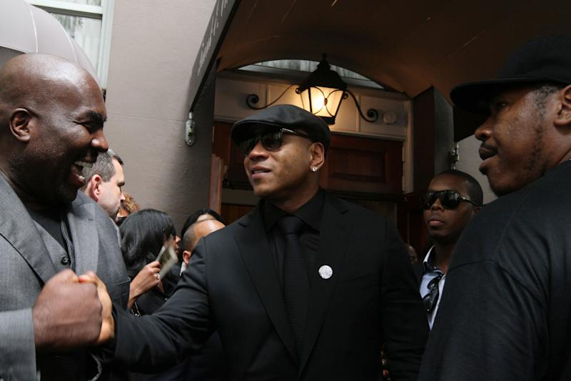 "LL Cool J, center, leaves the Frank E. Campbell Funeral Chapel following the service for hip-hop mogul Chris Lighty, Wednesday Sept. 5, 2012 in New York. Mourners in the packed chapel Wednesday included Sean ""Diddy"" Combs, Missy Elliott, Q-Tip, LL Cool J, Russell Simmons, 50 Cent and Grandmaster Flash. Lighty, the 44-year-old hip-hop mogul was found dead in his Bronx apartment last week with a gunshot wound to the head. (AP Photo/Tina Fineberg)"