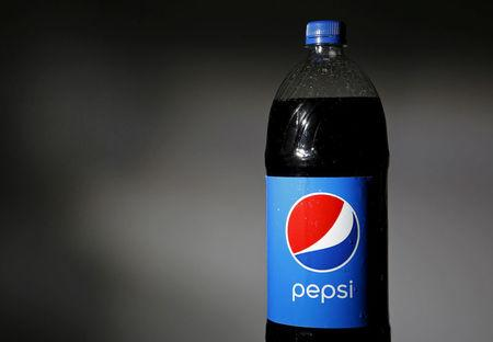 FILE PHOTO : A bottle of Pepsi is seen in this photo illustration February 10, 2015. REUTERS/Jim Young/Illustration/File Photo