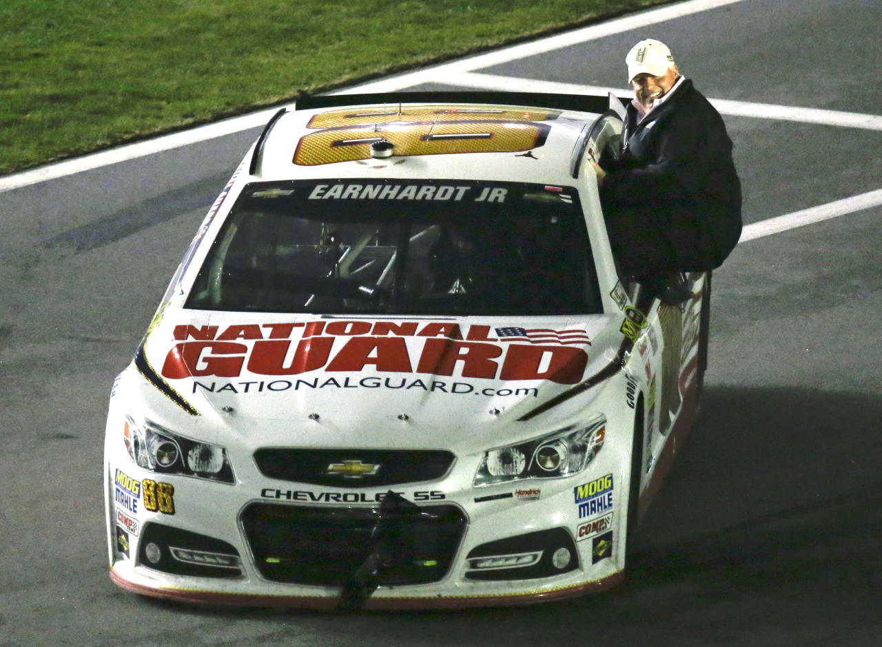 Car owner Rick Hendrick rides with Dale Earnhardt Jr. to Victory Lane as they celebrate after winning the Daytona 500 NASCAR Sprint Cup Series auto race at Daytona International Speedway in Daytona Beach, Fla., Sunday, Feb. 23, 2014. (AP Photo/John Raoux)