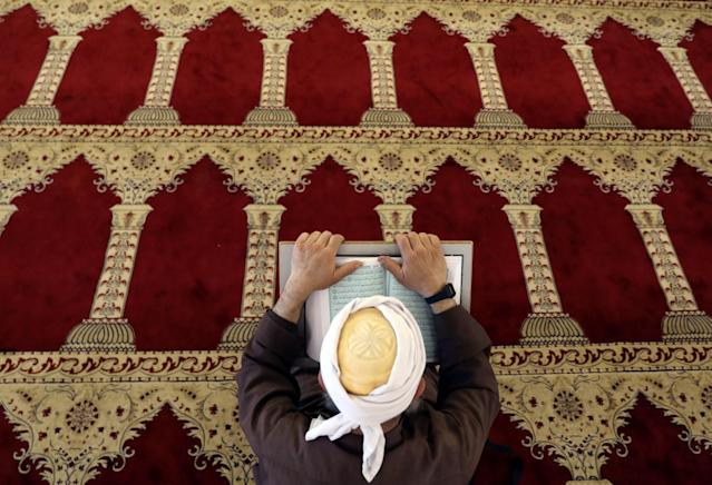 <p>A Palestinian man reads the Quran in al-Aqsa Mosque, on the compound known to Muslims as al-Haram al-Sharif and to Jews as Temple Mount, in Jerusalem's Old City during the holy month of Ramadan, May 28, 2017. (Ammar Awad/Reurters) </p>