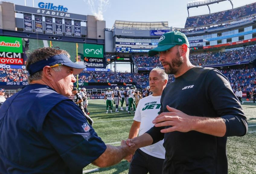Bill Belichick shaking hands with Adam Gase