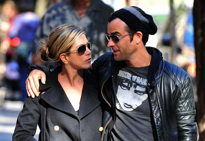 NEW YORK, NY - SEPTEMBER 18: Jennifer Aniston and Justin Theroux walk in the West Village on September 18, 2011 in New York City. (Photo by James Devaney/WireImage)