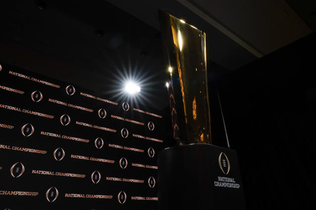 The trophy is displayed before a news conference for the NCAA College Football Playoff national championship game Sunday, Jan. 12, 2020, in New Orleans. Clemson is scheduled to play LSU on Monday. (AP Photo/David J. Phillip)