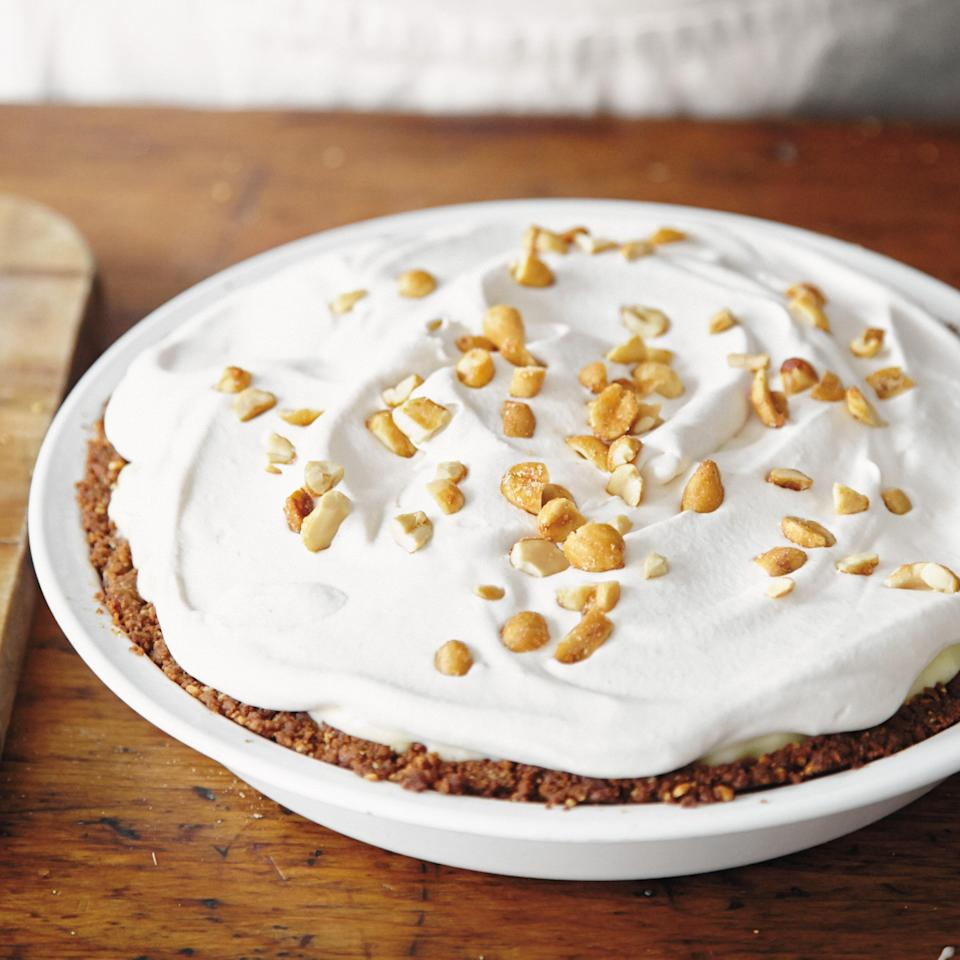 """Fresh banana pudding, topped with peanut butter whipped cream in a peanut butter-bacon cookie crust. Need we say more? <a href=""""https://www.epicurious.com/recipes/food/views/elvis-pie-51229410?mbid=synd_yahoo_rss"""" rel=""""nofollow noopener"""" target=""""_blank"""" data-ylk=""""slk:See recipe."""" class=""""link rapid-noclick-resp"""">See recipe.</a>"""