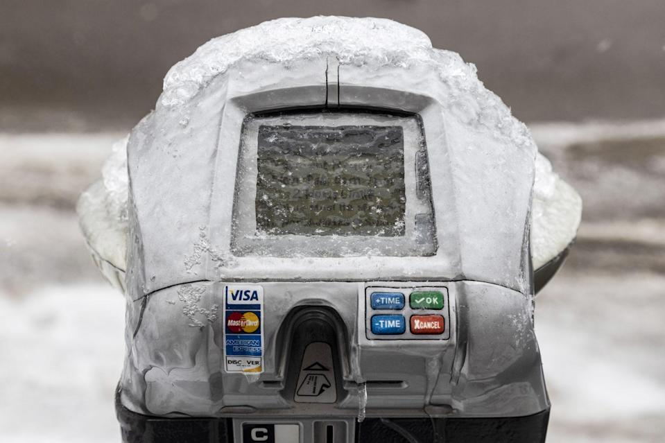 <p>In Athens County, Ohio, a parking meter is frozen over with ice. </p>