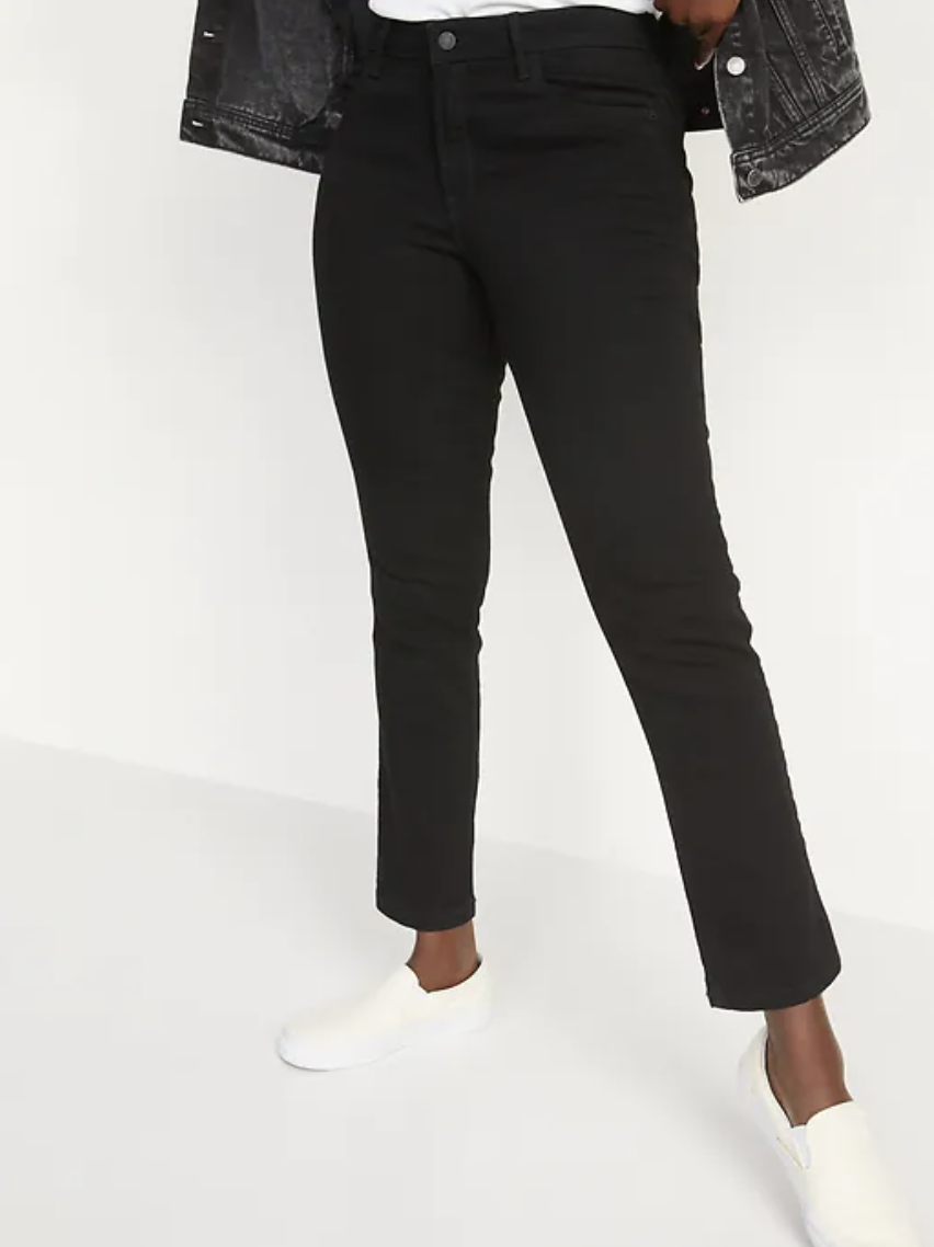 woman wearing white shoes and Mid-Rise Power Slim Straight Black Jeans