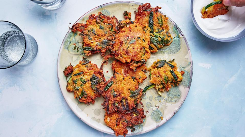 """These crispy zucchini fritters are a great way to use up your backyard <a href=""""https://www.epicurious.com/ingredients/what-to-do-with-all-that-zucchini-gallery?mbid=synd_yahoo_rss"""" rel=""""nofollow noopener"""" target=""""_blank"""" data-ylk=""""slk:zucchini"""" class=""""link rapid-noclick-resp"""">zucchini</a> harvest. They take inspiration from the Bengali onion snack piyaju. Soaked and blended red lentils make up the batter, which is spiked with turmeric and chile powder. <a href=""""https://www.epicurious.com/recipes/food/views/zucchini-lentil-fritters-with-lemony-yogurt?mbid=synd_yahoo_rss"""" rel=""""nofollow noopener"""" target=""""_blank"""" data-ylk=""""slk:See recipe."""" class=""""link rapid-noclick-resp"""">See recipe.</a>"""