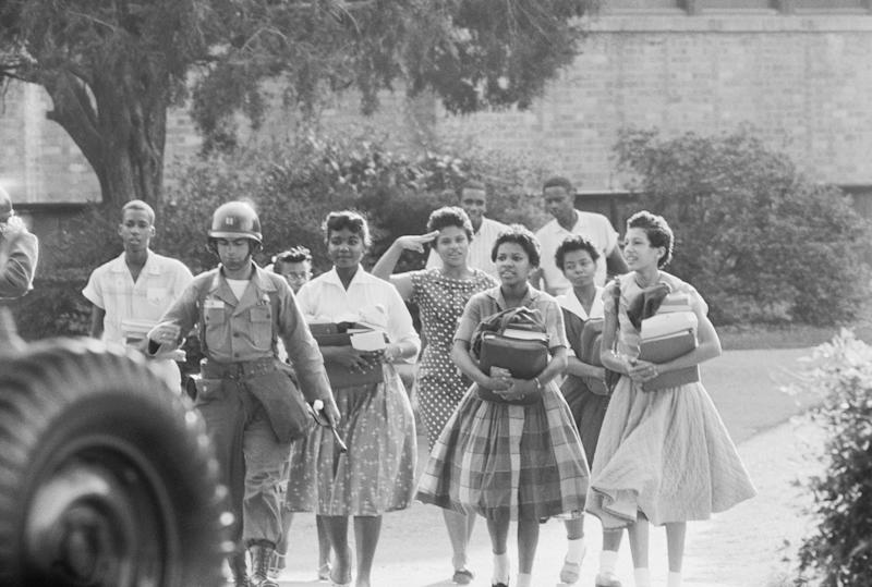 Members of the Little Rock Nine leave Central High School at the end of a school day. (Bettmann via Getty Images)