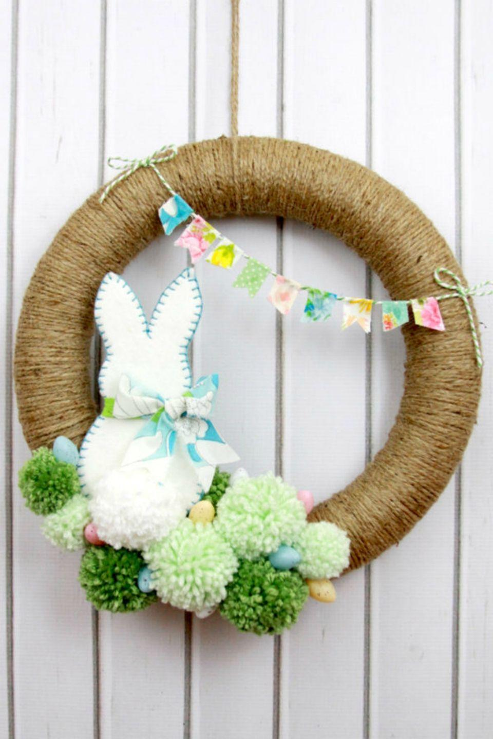 """<p>The felt bunny with his little pom pom tail is almost too cute to handle on this gorgeous Easter wreath.</p><p><strong>Get the tutorial at <a href=""""http://www.flamingotoes.com/2015/03/spring-bunny-pom-pom-wreath/"""" rel=""""nofollow noopener"""" target=""""_blank"""" data-ylk=""""slk:Flamingo Toes"""" class=""""link rapid-noclick-resp"""">Flamingo Toes</a>. </strong></p><p><a class=""""link rapid-noclick-resp"""" href=""""https://www.amazon.com/Pepperell-Assorted-Standard-Colors-Package/dp/B00114OW3U?tag=syn-yahoo-20&ascsubtag=%5Bartid%7C10050.g.4088%5Bsrc%7Cyahoo-us"""" rel=""""nofollow noopener"""" target=""""_blank"""" data-ylk=""""slk:SHOP POM-POMS"""">SHOP POM-POMS</a><strong><br></strong></p>"""