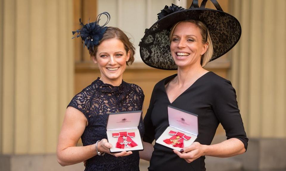 Helen, left, and Kate Richardson-Walsh pose after each receiving honours at Buckingham Palace in 2017