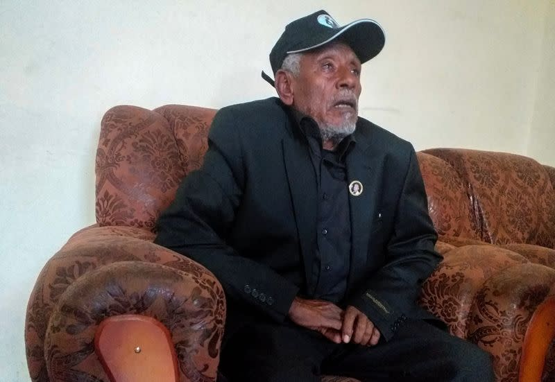 Hundeessaa Bonsa, father to the slain Ethiopian political singer Haacaaluu Hundeessaa talks during a Reuters interview at their home in Ambo