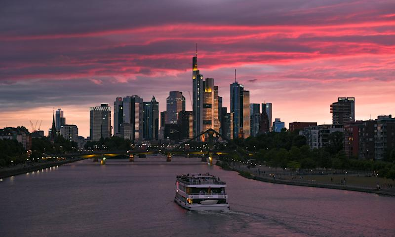 10 July 2020, Hessen, Frankfurt/Main: At sunset, a party ship sails along the Main River on the level of Frankfurt's eastern harbour towards the skyline of the banking city. Photo: Arne Dedert/dpa (Photo by Arne Dedert/picture alliance via Getty Images)