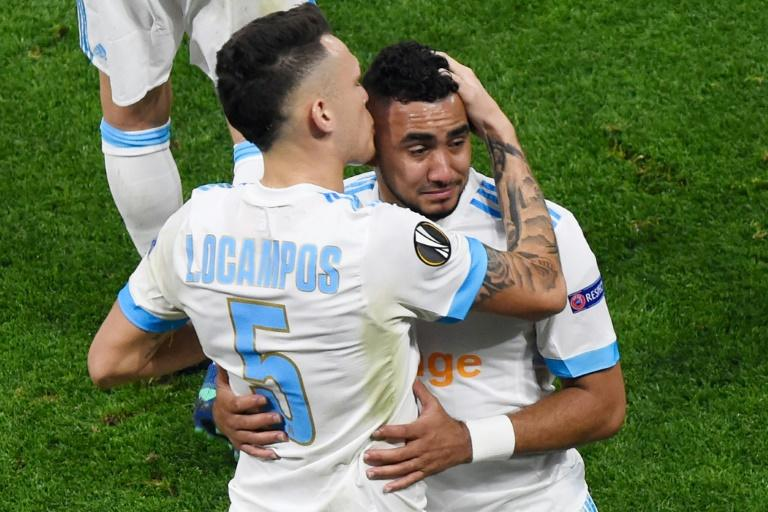 Marseille skipper Dimitri Payet is comforted by Lucas Ocampos as he comes off injured in the first half