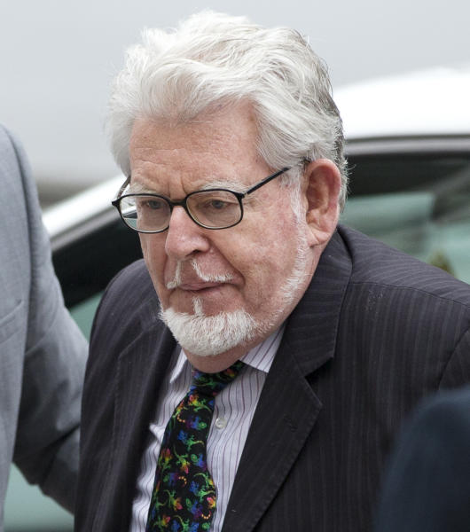 Veteran entertainer Rolf Harris arrives at Westminster Magistrate's Court in London, Monday, Sept. 23, 2013. Harris faces nine counts of indecent assault on victims aged 14 and 15 and four counts of making indecent images. Harris, 83, has had musical hits, hosted television shows, painted an official portrait of the queen for her 80th birthday in 2006, and performed at the monarch's Diamond Jubilee concert last year. (AP Photo/Alastair Grant)