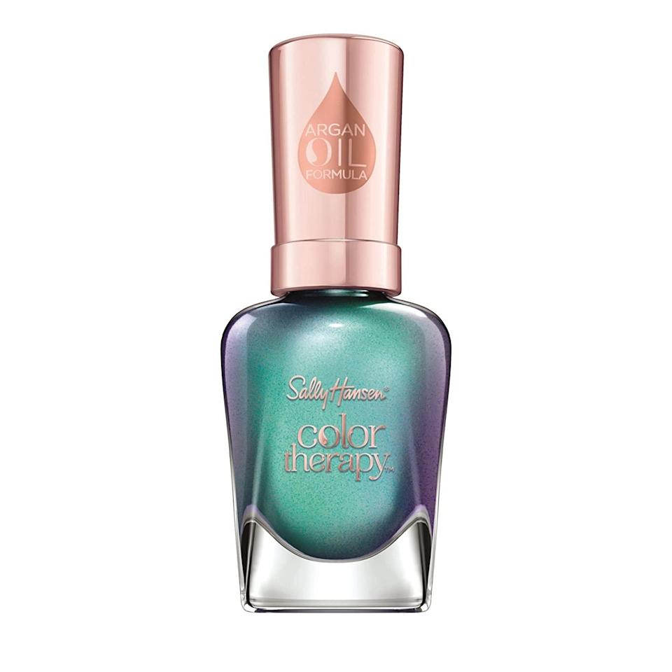 """<p>You may accidentally put your foot in your mouth a few times over the next month. But, with blue being the magical color that ensures concise, direct, and clear communication, if you choose to wear this cool shade on your nails, then all of that drama can be avoided. </p> <p><strong>To shop: </strong>$5; <a href=""""https://www.amazon.com/Sally-Hansen-Therapy-Polish-Reflection/dp/B01JOL4D0S/ref=as_li_ss_tl?ie=UTF8&linkCode=ll1&tag=isbeuhaircolorsforlibraseasonlstardustsep20-20&linkId=1b920db39777f241a4653d809ce171f9"""" rel=""""nofollow noopener"""" target=""""_blank"""" data-ylk=""""slk:amazon.com"""" class=""""link rapid-noclick-resp"""">amazon.com</a></p>"""