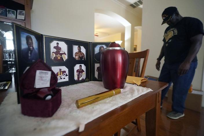 Former U.S. Marine and retired law enforcement officer Marvin Wilson pauses next to an urn holding the ashes of his son along with photos of Tyrell Wilson in Fort Worth, Texas, Monday, May 17, 2021. (AP Photo/LM Otero)