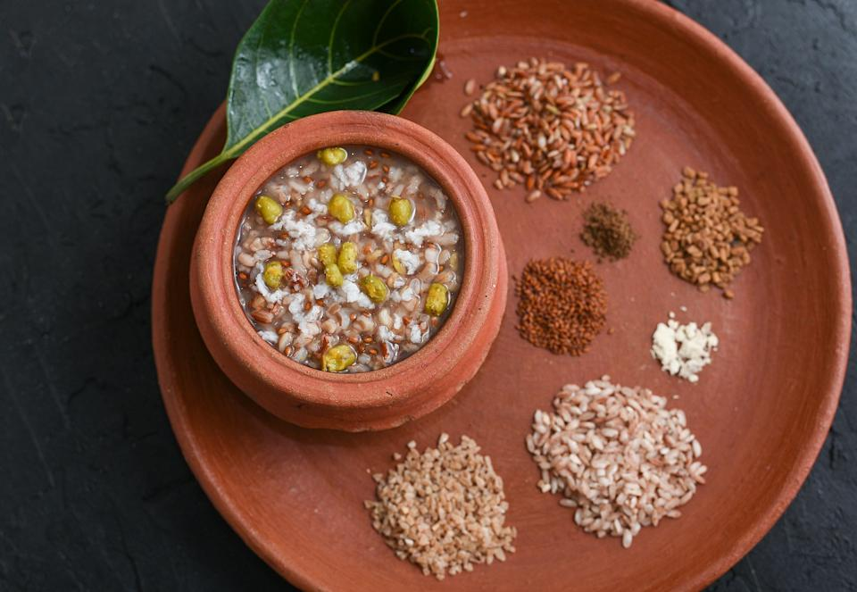 Ayurvedic porridge, Karkidaka Kanji herbal gruel in clay pot. Aged grains of jowar, wheat, and rice, help to protect the digestive fire during the rainy season. They are also very easy to digest
