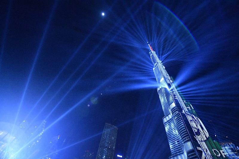 A picture taken on December 31, 2017, shows a laser show at Burj Khalifa, the tallest tower in the world, to mark the New Year's eve celebrations in Dubai