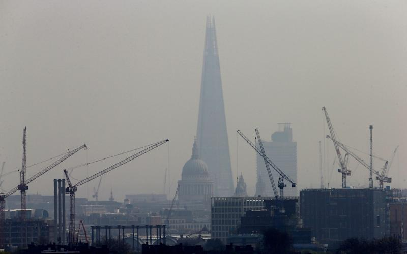 Smog blankets the Shard and St Paul's Cathedral in London - REUTERS