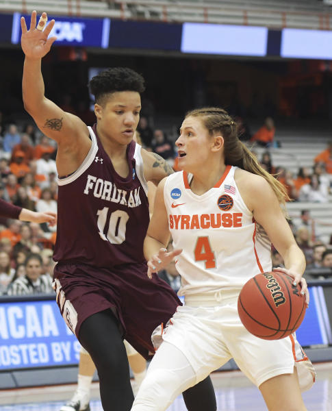 Syracuse's Tiana Mangakahia (4) drives towards the basket as Fordham's Bre Cavanaugh defends during of a first-round game in the NCAA womens college basketball tournament in Syracuse, N.Y., Saturday, March 23, 2019. (AP Photo/Heather Ainsworth)