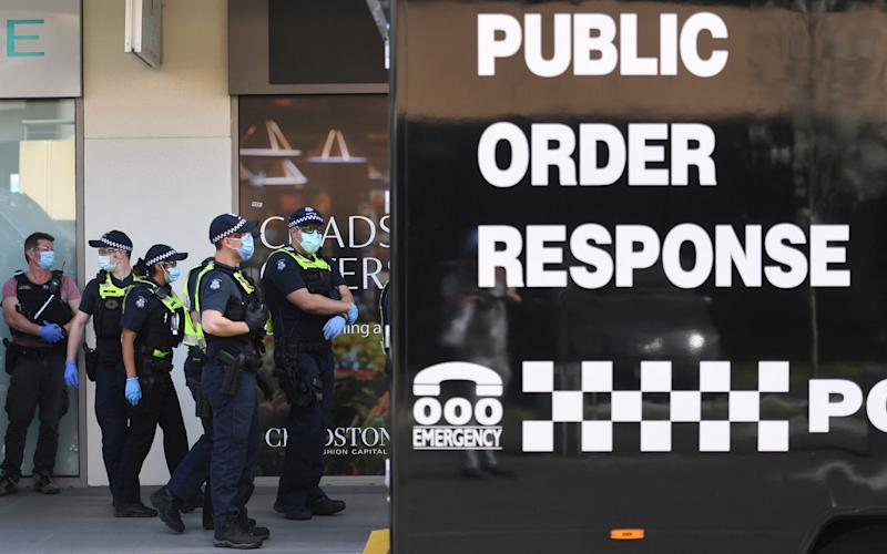 Police prepare to patrol through a shopping centre after an anti-lockdown protest in the Melbourne - AFP