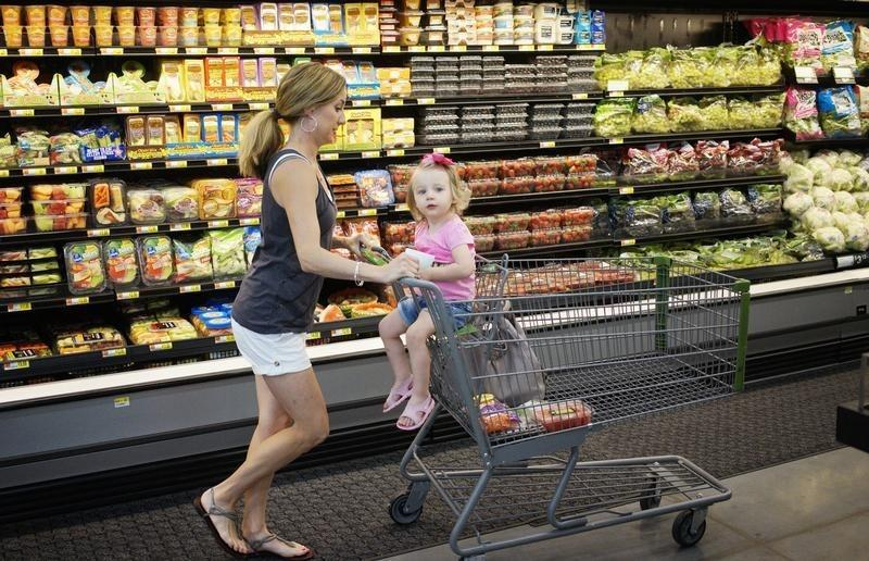 A woman and child shop at a Walmart in Bentonville
