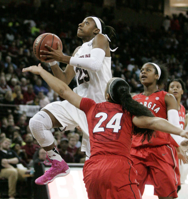South Carolina's Tiffany Mitchell (25) drives for the basket as Georgia's Marjorie Butler (24) defends during the first half of an NCAA college basketball game Thursday, Feb. 27, 2014, in Columbia, S.C. (AP Photo/Mary Ann Chastain)