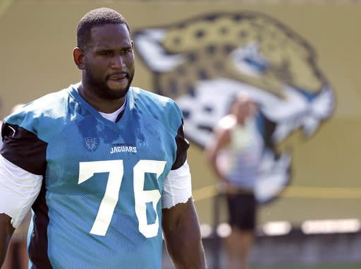 Branden Albert told the Jaguars he wants to play again, after retiring last week. (AP)