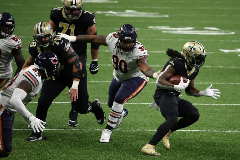 New Orleans running back Alvin Kamara runs with the ball in the Saints' NFL playoff victory over the Chicago Bears
