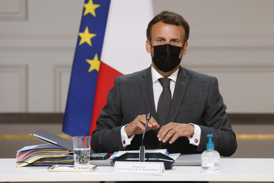 French President Emmanuel Macron chairs the weekly Cabinet meeting at the Elysee presidential palace in Paris, Wednesday June 9, 2021. Bubbling beneath France's political landscape is an assortment of ultra-right groups, a subculture that shot to the nation's attention when a young man slapped Macron and blurted out a centuries-old royalist cry. (Ludovic Marin/Pool Photo via AP)