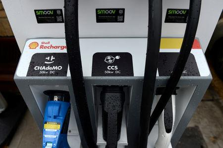 FILE PHOTO: Electric chargers are seen at the Holloway Road Shell station where Shell is launching its first fast electric vehicle charging station in London