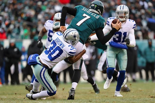 <p>Quarterback Nate Sudfeld #7 of the Philadelphia Eagles is sacked by cornerback Anthony Brown #30 of the Dallas Cowboys during the second half of the game at Lincoln Financial Field on December 31, 2017 in Philadelphia, Pennsylvania. (Photo by Elsa/Getty Images) </p>
