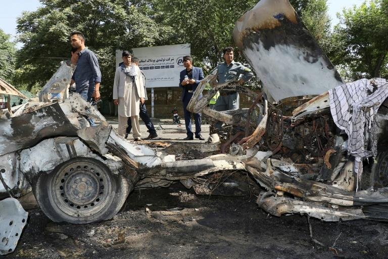 Afghan security personnel investigate a bomb explosion in front of Kabul University on July 19, 2019, as Afghanistan experienced weeks of intensified violence (AFP Photo/STR)