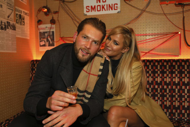 Caroline Flack and Lewis Burton at the opening of Cahoots Ticket Hall and Control Room in Soho, London. (Matrix/MediaPunch /IPX)