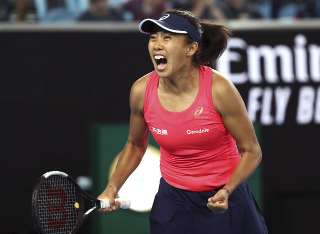China's Zhang Shuai celebrates after defeating United States' Sloane Stephens in their first round singles match the Australian Open tennis championship in Melbourne, Australia, Monday, Jan. 20, 2020. (AP Photo/Dita Alangkara)