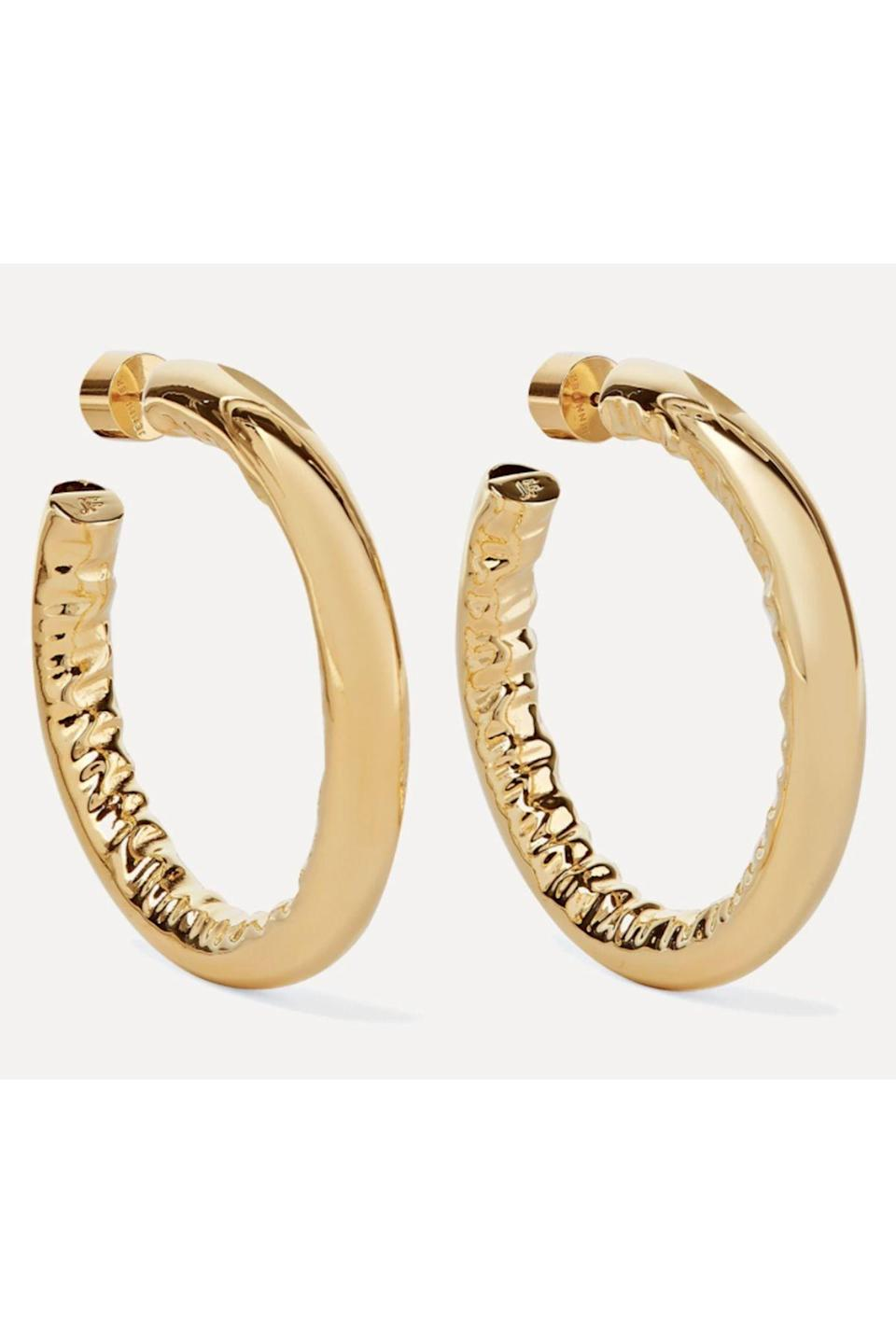 """<p><strong>Jennifer Fisher</strong></p><p>net-a-porter.com</p><p><strong>$375.00</strong></p><p><a href=""""https://go.redirectingat.com?id=74968X1596630&url=https%3A%2F%2Fwww.net-a-porter.com%2Fen-us%2Fshop%2Fproduct%2Fjennifer-fisher%2F1-5-baby-jennifer-gold-plated-hoop-earrings%2F1228093&sref=https%3A%2F%2Fwww.townandcountrymag.com%2Fstyle%2Fjewelry-and-watches%2Fg33469392%2Fthe-weekly-covet-july-31-2020%2F"""" rel=""""nofollow noopener"""" target=""""_blank"""" data-ylk=""""slk:Shop Now"""" class=""""link rapid-noclick-resp"""">Shop Now</a></p><p>When you think hoops Jennifer Fisher is the top of that list! These pair are her iconic thick gold but in a smaller silhouette, perfect for day to day.</p>"""