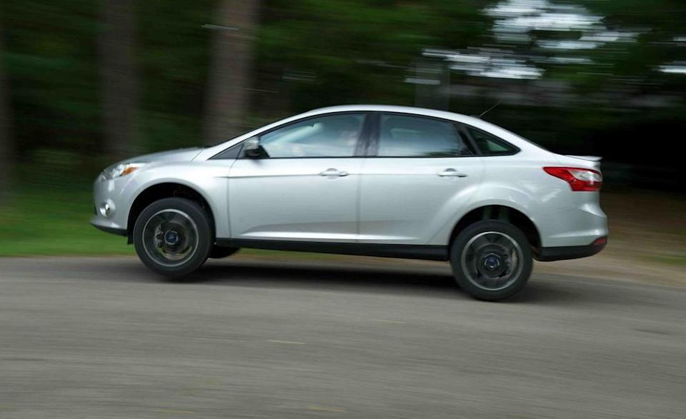 """<p>Speaking of boring, the Ford Focus sedan—painted silver, no less—that we pitted against the Dodge Dart barely managed to lift off the pavement during its jump attempt. The Focus might not have flown as high, but it can wave <a href=""""http://www.caranddriver.com/features/2012-10best-cars-feature-2012-ford-focus-page-5"""" rel=""""nofollow noopener"""" target=""""_blank"""" data-ylk=""""slk:its 10Best Cars awards"""" class=""""link rapid-noclick-resp"""">its 10Best Cars awards</a> in the now discontinued Dart's face. If it weren't already clear, we do not factor in a car's ability to jump when making our annual selection of the 10 best cars on sale.</p>"""