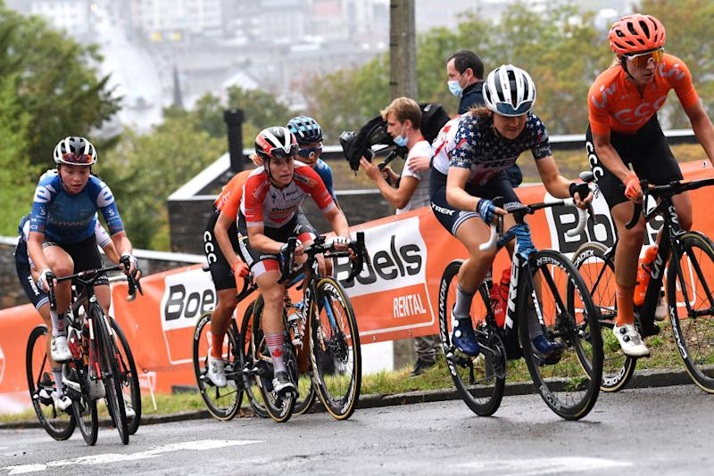 A group of riders struggle on the slopes of the Mur de Huy