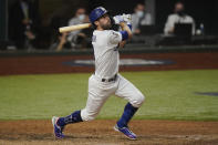 Los Angeles Dodgers' Chris Taylor watches his two-run home run against the Tampa Bay Rays during the fifth inning in Game 2 of the baseball World Series Wednesday, Oct. 21, 2020, in Arlington, Texas. (AP Photo/Eric Gay)