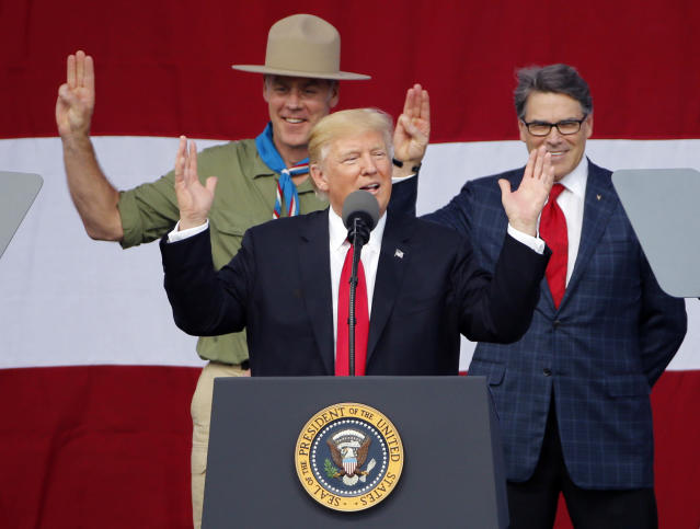 "<p>FILE – In this Monday, July 24, 2017 file photo, President Donald Trump, front left, gestures as former boys scouts, Interior Secretary Ryan Zinke, left, and Energy Secretary Rick Perry, watch at the 2017 National Boy Scout Jamboree at the Summit in Glen Jean, W.Va. Boy Scouts president Randall Stephenson told The Associated Press on Wednesday, July 26, in his first public comments on the furor over President Donald Trump's speech on Monday, that he'd be ""disingenuous"" if he suggested he was surprised by the Republican president's comments. Trump's speech and its aftermath were voted one of the top stories in West Virginia in 2017. (AP Photo/Steve Helber, File) </p>"