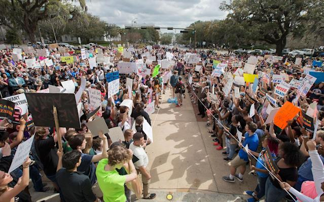 <p>Students gather on the steps of the old Florida Capitol protesting gun violence in Tallahassee, Fla., Wednesday, Feb. 21, 2018. Students at schools across Broward and Miami-Dade counties in South Florida planned short walkouts Wednesday, the one week anniversary of the deadly shooting at Marjory Stoneman Douglas High School. (Photo: Mark Wallheiser/AP) </p>