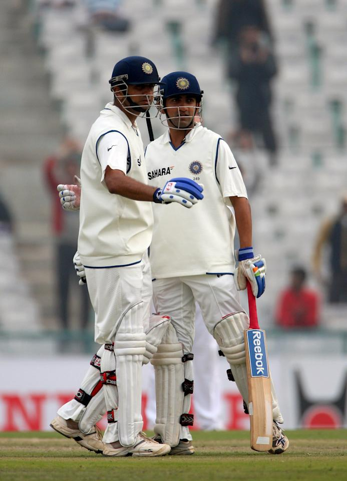 MOHALI, INDIA - DECEMBER 20:  Rahul Dravid of India celebrates reaching his century with Gautem Gambhir of India during day 2 of the Second Test Match between India and England at the PCA Stadium on December 20, 2008 in Mohali, India.  (Photo by Global Cricket Ventures/BCCI via Getty Images)